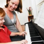 How Piano Lessons Can Get Your Kid's Grades Up and Build a Better Brain