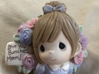 Check out this Precious Moments figurine. It will make a great Mother's Day Gift.